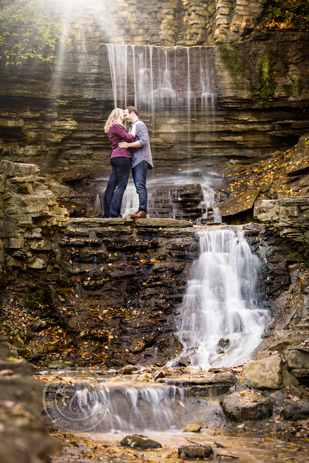 Hidden Falls Waterfall St Paul MN Engaged Couple